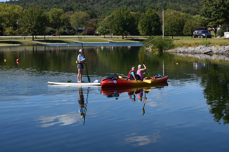 """An Inflatable Kayak Board and a Kayak Board in the lake"